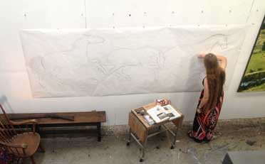 Ellen A. Cook working on scale drawing on paper